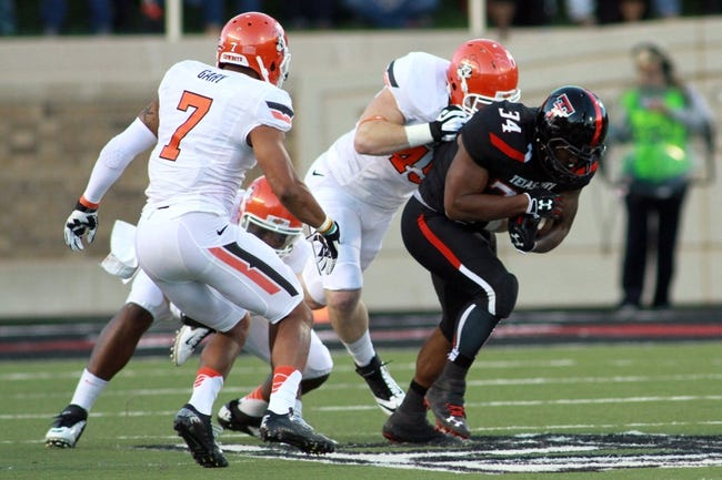 Nov 2, 2013; Lubbock, TX, USA; Texas Tech Red Raiders running back Kenny Williams (34) rushes against the Oklahoma State Cowboys in the first quarter at Jones AT&T Stadium. Mandatory Credit: Michael C. Johnson-USA TODAY Sports