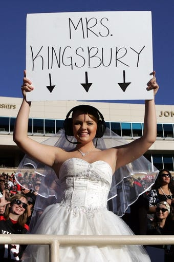 Nov 2, 2013; Lubbock, TX, USA; Texas Tech Red Raiders student Ellen Elizabeth Perron of Alpine, Texas shows her support for head coach Kliff Kingsbury (not pictured) in the game with the Oklahoma State Cowboys at Jones AT&T Stadium. Mandatory Credit: Michael C. Johnson-USA TODAY Sports