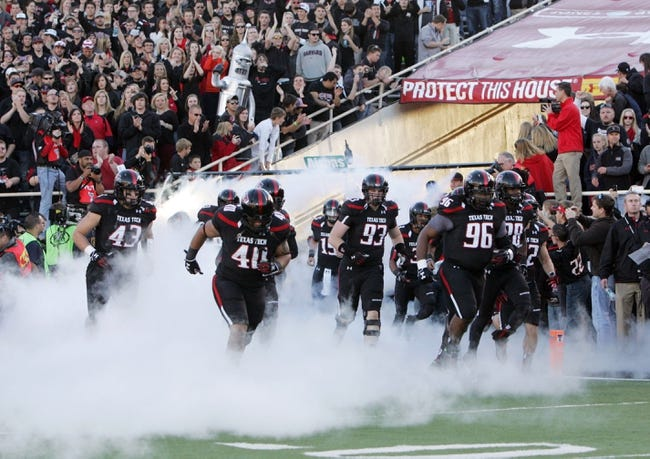 Nov 2, 2013; Lubbock, TX, USA; The Texas Tech Red Raiders enter the field in the game against the Oklahoma State Cowboys at Jones AT&T Stadium. Mandatory Credit: Michael C. Johnson-USA TODAY Sports