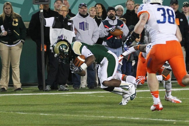 Nov 2, 2013; Fort Collins, CO, USA; Colorado State Rams wide receiver Charles Lovett (4) scores a touchdown against Boise State Broncos cornerback Donte Deayon (5) and linebacker Corey Bell (38) during the second quarter at Hughes Stadium. Mandatory Credit: Troy Babbitt-USA TODAY Sports