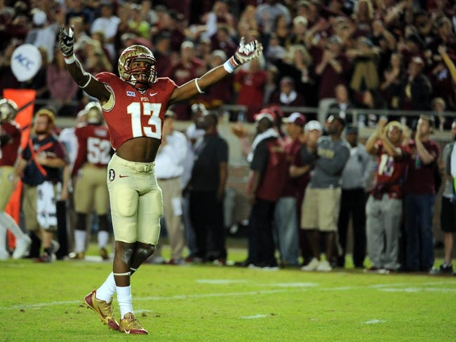 Nov 2, 2013; Tallahassee, FL, USA; Florida State Seminoles defensive back Jalen Ramsey (13) celebrates after a defensive stop during the game against the Miami Hurricanes at Doak Campbell Stadium. Mandatory Credit: Melina Vastola-USA TODAY Sports