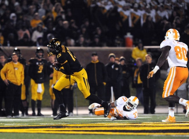 Nov 2, 2013; Columbia, MO, USA; Missouri Tigers wide receiver Dorial Green-Beckham (15) shakes off a tackle attempt from Tennessee Volunteers defensive back Brian Randolph (37) during the second half of the game at Faurot Field. Missouri won 31-3. Mandatory Credit: Denny Medley-USA TODAY Sports