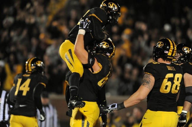 Nov 2, 2013; Columbia, MO, USA; Missouri Tigers running back Russell Hansbrough (32) is congratulated by offensive linesman Connor McGovern (60) after Hansbrough's touchdown during the second half of the game against the Tennessee Volunteers at Faurot Field. Missouri won 31-3. Mandatory Credit: Denny Medley-USA TODAY Sports