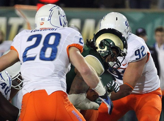 Nov 2, 2013; Fort Collins, CO, USA; Colorado State Rams running back Donnell Alexander (7) scores a touchdown against Boise State Broncos defensive end Kamalei Correa (92) and safety Dillon Lukehart (28) during the fourth quarter at Hughes Stadium. Mandatory Credit: Troy Babbitt-USA TODAY Sports