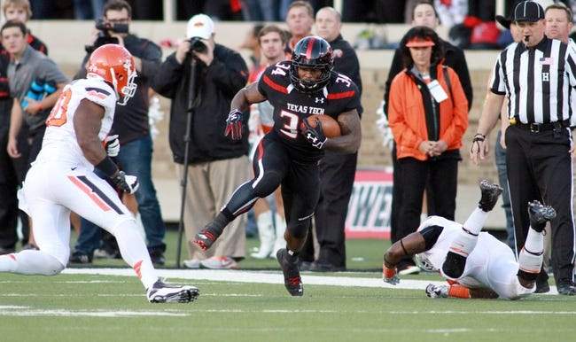 Nov 2, 2013; Lubbock, TX, USA; Texas Tech Red Raiders running back Kenny Williams (34) rushes against the Oklahoma State Cowboys in the second half at Jones AT&T Stadium. Mandatory Credit: Michael C. Johnson-USA TODAY Sports