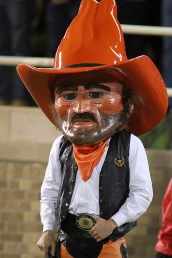 Nov 2, 2013; Lubbock, TX, USA; Oklahoma State Cowboys mascot Pistol Pete on the sidelines during the game against the Texas Tech Red Raiders at Jones AT&T Stadium. Mandatory Credit: Michael C. Johnson-USA TODAY Sports