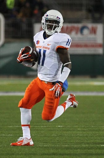 Nov 2, 2013; Fort Collins, CO, USA; Boise State Broncos wide receiver Shane Williams-Rhodes (11) runs against the Colorado State Rams during the first quarter at Hughes Stadium. The Broncos defeated the Rams 42-30. Mandatory Credit: Troy Babbitt-USA TODAY Sports