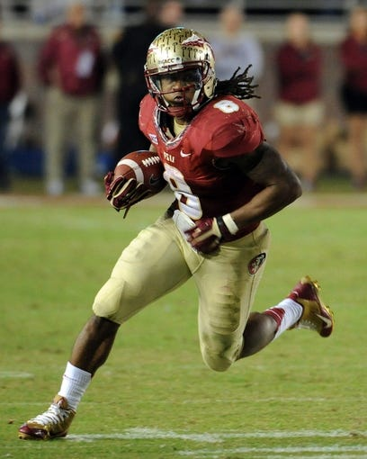 Nov 2, 2013; Tallahassee, FL, USA; Florida State Seminoles running back Devonta Freeman (8) runs the ball during the game against the Miami Hurricanes at Doak Campbell Stadium. Mandatory Credit: Melina Vastola-USA TODAY Sports