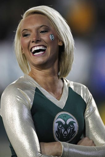 Nov 2, 2013; Fort Collins, CO, USA; A Colorado State Rams cheerleader performs against the Boise State Broncos at Hughes Stadium. The Broncos defeated the Rams 42-30. Mandatory Credit: Troy Babbitt-USA TODAY Sports