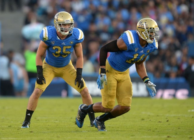 Nov 2, 2013; Pasadena, CA, USA; UCLA Bruins linebackers Anthony Barr (11) and Jordan Zumwalt (35) during the game against the Colorado Buffaloes at Rose Bowl. UCLA defeated Colorado 45-23. Mandatory Credit: Kirby Lee-USA TODAY Sports