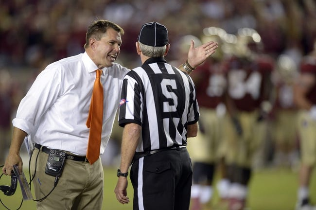 Nov 2, 2013; Tallahassee, FL, USA; Miami Hurricanes head coach Al Golden questions a call with side judge Watts Key during the third quarter against the Florida State Seminoles at Doak Campbell Stadium. The Florida State Seminoles defeated the Miami Hurricanes 41-14. Mandatory Credit: John David Mercer-USA TODAY Sports