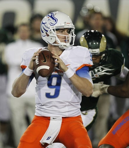 Nov 2, 2013; Fort Collins, CO, USA; Boise State Broncos quarterback Grant Hedrick (9) throws against the Colorado State Rams during the second quarter at Hughes Stadium. The Broncos defeated the Rams 42-30. Mandatory Credit: Troy Babbitt-USA TODAY Sports