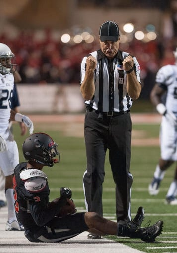 Nov 2, 2013; Fresno, CA, USA; The referee signals a catch after Fresno State Bulldogs wide receiver Josh Harper (3) catches the ball on the sideline during the second quarter of the game against the Nevada Wolf Pack at Bulldog Stadium. Mandatory Credit: Ed Szczepanski-USA TODAY Sports