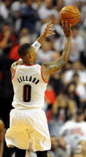 Nov 2, 2013; Portland, OR, USA; Portland Trail Blazers point guard Damian Lillard (0) shoots the ball during the fourth quarter of the game against the San Antonio Spurs at  the Moda Center. The Blazers won the game 115-105. Mandatory Credit: Steve Dykes-USA TODAY Sports