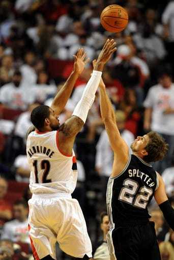 Nov 2, 2013; Portland, OR, USA; Portland Trail Blazers power forward LaMarcus Aldridge (12) shoots the ball over San Antonio Spurs center Tiago Splitter (22) during the fourth quarter of the game at the Moda Center. The Blazers won the game 115-105. Mandatory Credit: Steve Dykes-USA TODAY Sports