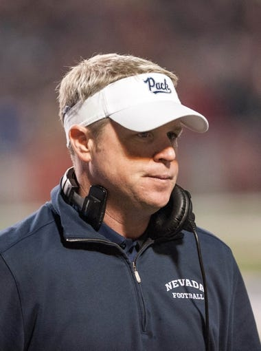Nov 2, 2013; Fresno, CA, USA; Nevada Wolf Pack head coach Brian Polian looks on during the game between the Fresno State Bulldogs and Nevada Wolf Pack at Bulldog Stadium. Fresno State won 41-23. Mandatory Credit: Ed Szczepanski-USA TODAY Sports
