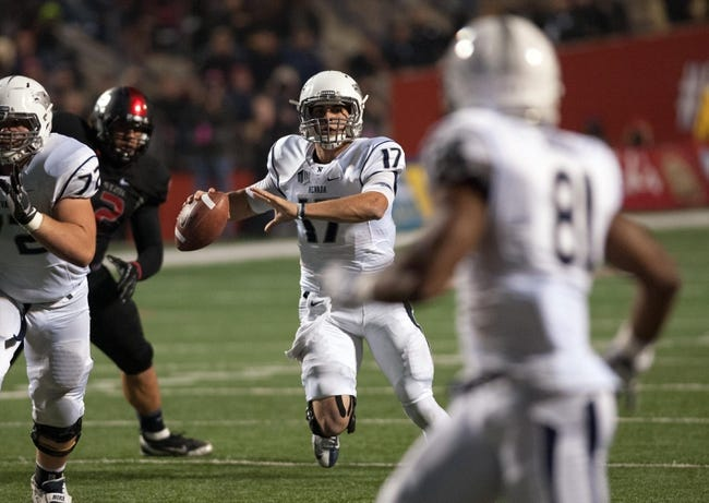 Nov 2, 2013; Fresno, CA, USA; Nevada Wolf Pack quarterback Cody Fajardo (17) looks for a receiver down field during the second quarter of the game against the Fresno State Bulldogs at Bulldog Stadium. Fresno State won 41-23. Mandatory Credit: Ed Szczepanski-USA TODAY Sports
