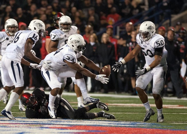 Nov 2, 2013; Fresno, CA, USA; Nevada Wolf Pack defensive back Charles Garrett (24) recovers a fumble against the Fresno State Bulldogs during the fourth quarter  at Bulldog Stadium. Fresno State won 41-23. Mandatory Credit: Ed Szczepanski-USA TODAY Sports