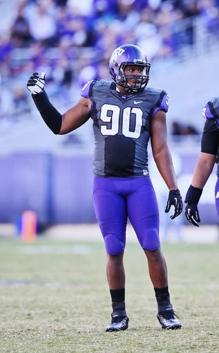 Nov 2, 2013; Fort Worth, TX, USA; TCU Horned Frogs defensive tackle Terrell Lathan (90) during the game against the West Virginia Mountaineers at Amon G. Carter Stadium. West Virginia won 30-27. Mandatory Credit: Kevin Jairaj-USA TODAY Sports