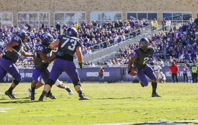 Nov 2, 2013; Fort Worth, TX, USA; TCU Horned Frogs quarterback Trevone Boykin (2) runs during the game against the West Virginia Mountaineers at Amon G. Carter Stadium. West Virginia won 30-27. Mandatory Credit: Kevin Jairaj-USA TODAY Sports