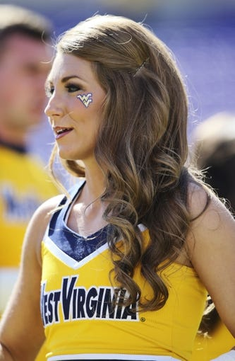 Nov 2, 2013; Fort Worth, TX, USA; West Virginia Mountaineers cheerleader during the game against the TCU Horned Frogs at Amon G. Carter Stadium. West Virginia won 30-27. Mandatory Credit: Kevin Jairaj-USA TODAY Sports