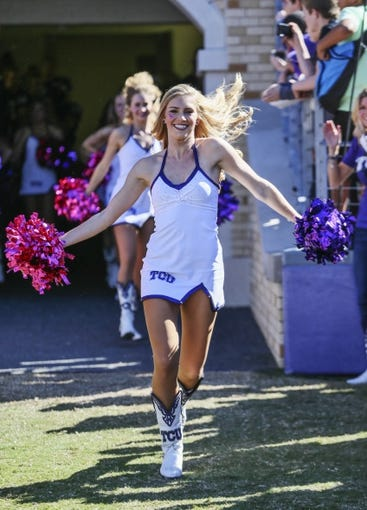 Nov 2, 2013; Fort Worth, TX, USA; TCU Horned Frogs showgirl performs during the game against the West Virginia Mountaineers at Amon G. Carter Stadium. West Virginia won 30-27. Mandatory Credit: Kevin Jairaj-USA TODAY Sports