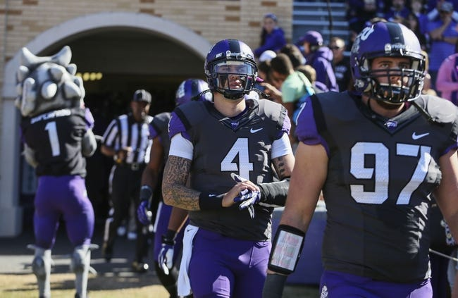 Nov 2, 2013; Fort Worth, TX, USA; TCU Horned Frogs quarterback Casey Pachall (4) and  defensive end Jon Koontz (97) walk onto the field before the game against the West Virginia Mountaineers at Amon G. Carter Stadium. West Virginia won 30-27. Mandatory Credit: Kevin Jairaj-USA TODAY Sports
