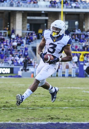Nov 2, 2013; Fort Worth, TX, USA; West Virginia Mountaineers running back Charles Sims (3) scores a touchdown during the game against the TCU Horned Frogs at Amon G. Carter Stadium. West Virginia won 30-27. Mandatory Credit: Kevin Jairaj-USA TODAY Sports