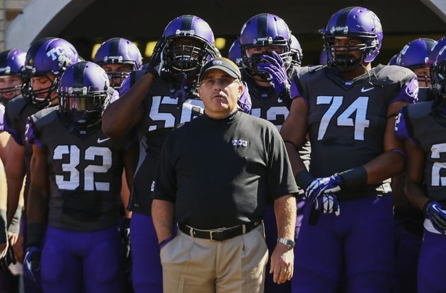 Nov 2, 2013; Fort Worth, TX, USA; TCU Horned Frogs head coach Gary Patterson leads his team onto the field before the game against the West Virginia Mountaineers at Amon G. Carter Stadium. West Virginia won 30-27. Mandatory Credit: Kevin Jairaj-USA TODAY Sports