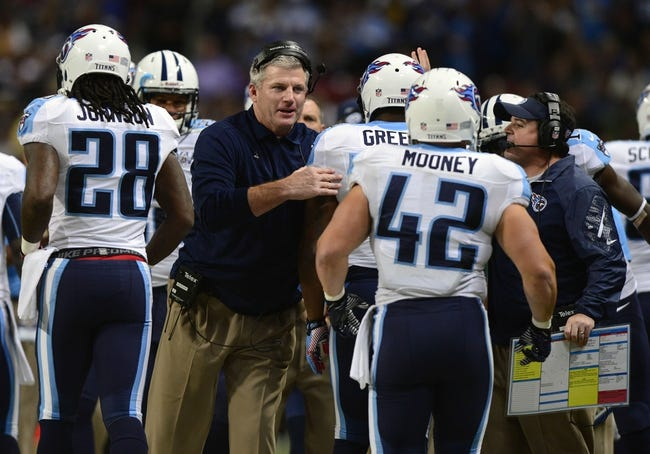 Nov 3, 2013; St. Louis, MO, USA; Tennessee Titans head coach Mike Munchak congratulates Tennessee Titans running back Shonn Greene (23) after he scored a touchdown against the St. Louis Rams during the first half at the Edward Jones Dome. Tennessee defeated St. Louis 28-21. Mandatory Credit: Jeff Curry-USA TODAY Sports