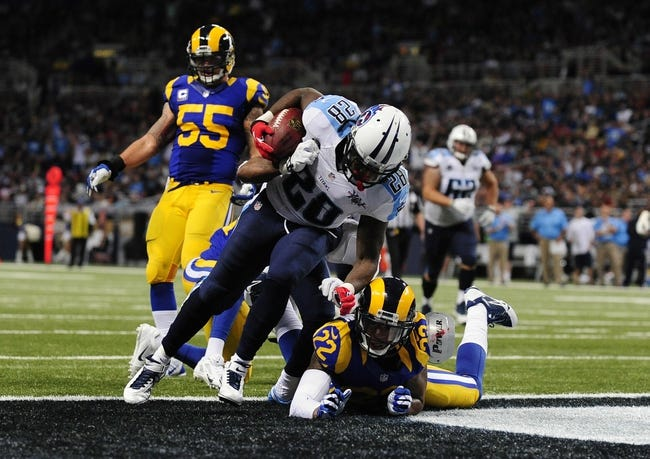 Nov 3, 2013; St. Louis, MO, USA; Tennessee Titans running back Chris Johnson (28) scores on a 14 yard run as St. Louis Rams cornerback Trumaine Johnson (22) defends during the second half at the Edward Jones Dome. Tennessee defeated St. Louis 28-21. Mandatory Credit: Jeff Curry-USA TODAY Sports