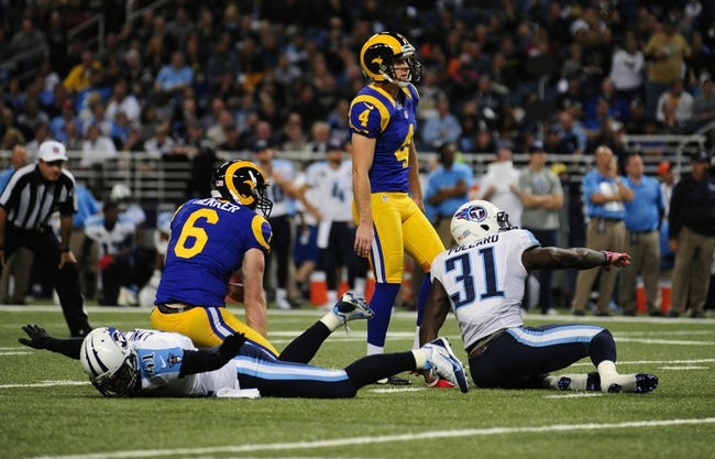 Nov 3, 2013; St. Louis, MO, USA; St. Louis Rams kicker Greg Zuerlein (4) looks on after missing a 44 yard field goal as Tennessee Titans defensive back Corey Lynch (41) and strong safety Bernard Pollard (31) celebrate during the first half at the Edward Jones Dome. Tennessee defeated St. Louis 28-21. Mandatory Credit: Jeff Curry-USA TODAY Sports