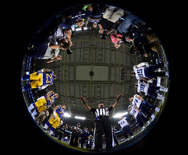 Nov 3, 2013; St. Louis, MO, USA; A general view of the coin toss with referee Pete Morelli (135) before the game between the St. Louis Rams and the Tennessee Titans at the Edward Jones Dome. Mandatory Credit: Scott Rovak-USA TODAY Sports