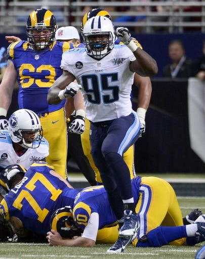 Nov 3, 2013; St. Louis, MO, USA; Tennessee Titans defensive end Kamerion Wimbley (95) celebrates after the Titans recovered a fumble by St. Louis Rams quarterback Kellen Clemens (10) during the second half at the Edward Jones Dome. The Titans defeated the Rams 28-21. Mandatory Credit: Scott Rovak-USA TODAY Sports