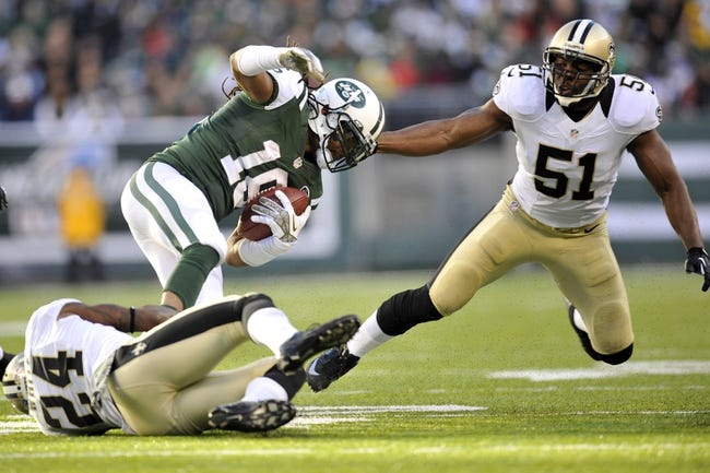 Nov 3, 2013; East Rutherford, NJ, USA; New Orleans Saints cornerback Corey White (24) trips up New York Jets wide receiver Josh Cribbs (16) during the second half at MetLife Stadium. The Jets won the game 26-20. Mandatory Credit: Joe Camporeale-USA TODAY Sports