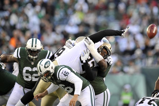 Nov 3, 2013; East Rutherford, NJ, USA; New Orleans Saints nose tackle John Jenkins (92) attempts to block a field goal against the New York Jets during the second half at MetLife Stadium. The Jets won the game 26-20. Mandatory Credit: Joe Camporeale-USA TODAY Sports