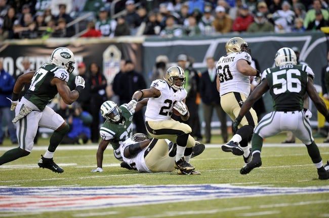 Nov 3, 2013; East Rutherford, NJ, USA; New Orleans Saints running back Pierre Thomas (23) runs the ball against the New York Jets during the second half at MetLife Stadium. The Jets won the game 26-20. Mandatory Credit: Joe Camporeale-USA TODAY Sports