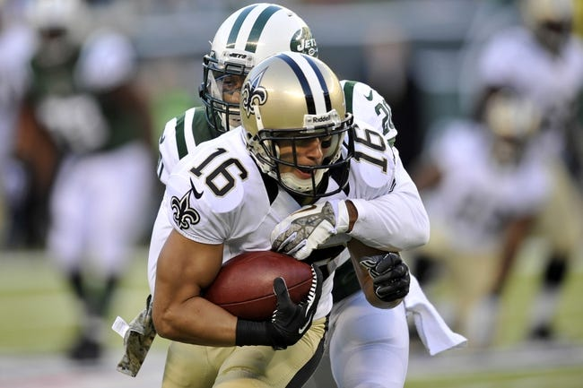 Nov 3, 2013; East Rutherford, NJ, USA; New York Jets cornerback Kyle Wilson (20) tackles New Orleans Saints wide receiver Lance Moore (16) after a reception during the second half at MetLife Stadium. The Jets won the game 26-20. Mandatory Credit: Joe Camporeale-USA TODAY Sports