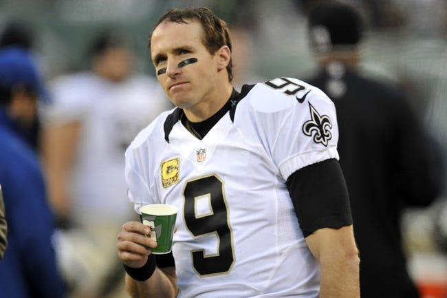 Nov 3, 2013; East Rutherford, NJ, USA; New Orleans Saints quarterback Drew Brees (9) reacts against the New York Jets during the second half at MetLife Stadium. The Jets won the game 26-20. Mandatory Credit: Joe Camporeale-USA TODAY Sports
