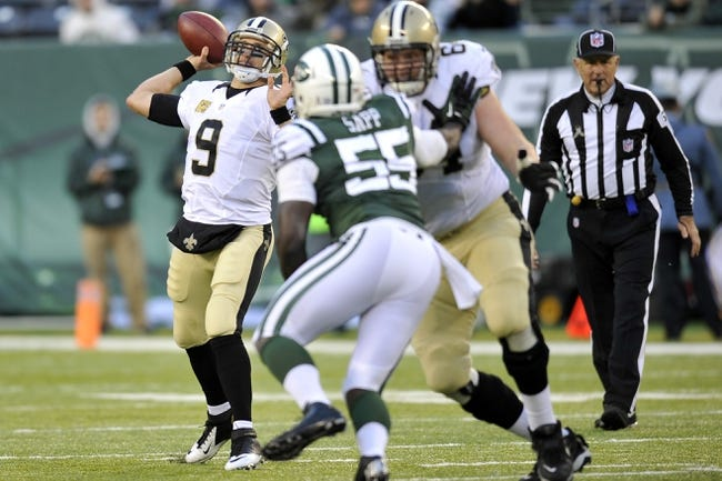 Nov 3, 2013; East Rutherford, NJ, USA; New Orleans Saints quarterback Drew Brees (9) throws a pass against the New York Jets during the second half at MetLife Stadium. The Jets won the game 26-20. Mandatory Credit: Joe Camporeale-USA TODAY Sports