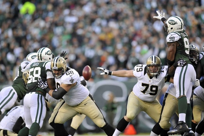 Nov 3, 2013; East Rutherford, NJ, USA; New York Jets outside linebacker Quinton Coples (98) attempts to block a New Orleans Saints field goal attempt during the second half at MetLife Stadium. The Jets won the game 26-20. Mandatory Credit: Joe Camporeale-USA TODAY Sports