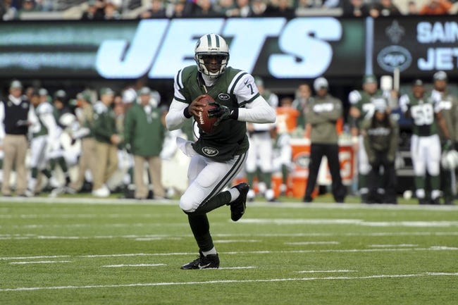 Nov 3, 2013; East Rutherford, NJ, USA; New York Jets quarterback Geno Smith (7) rolls out against the New Orleans Saints during the first half at MetLife Stadium. The Jets won the game 26-20. Mandatory Credit: Joe Camporeale-USA TODAY Sports