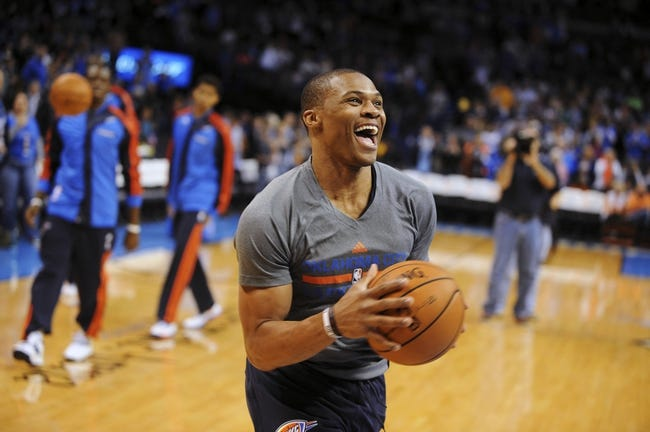 Nov 3, 2013; Oklahoma City, OK, USA; Oklahoma City Thunder point guard Russell Westbrook (0) laughs before the game against the Phoenix Suns at Chesapeake Energy Arena. Mandatory Credit: Mark D. Smith-USA TODAY Sports