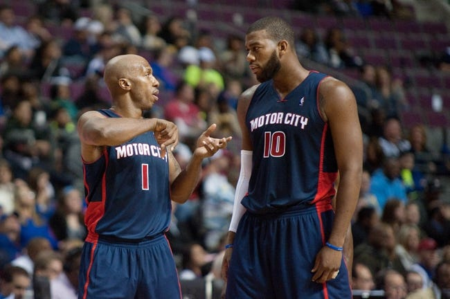 Nov 3, 2013; Auburn Hills, MI, USA; Detroit Pistons point guard Chauncey Billups (1) talks with center Greg Monroe (10) during the second quarter against the Boston Celtics at The Palace of Auburn Hills. Mandatory Credit: Tim Fuller-USA TODAY Sports