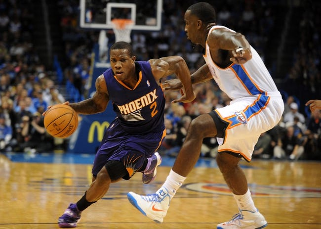 Nov 3, 2013; Oklahoma City, OK, USA; Phoenix Suns point guard Eric Bledsoe (2) handles the ball against Oklahoma City Thunder center Kendrick Perkins (5) during the first quarter at Chesapeake Energy Arena. Mandatory Credit: Mark D. Smith-USA TODAY Sports