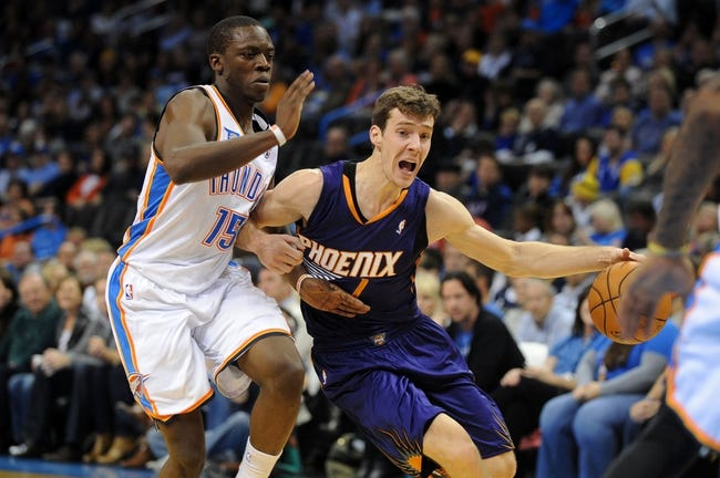Nov 3, 2013; Oklahoma City, OK, USA; Phoenix Suns point guard Goran Dragic (1) handles the ball against Oklahoma City Thunder point guard Reggie Jackson (15) during the second quarter at Chesapeake Energy Arena. Mandatory Credit: Mark D. Smith-USA TODAY Sports