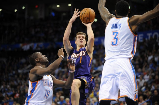 Nov 3, 2013; Oklahoma City, OK, USA; Phoenix Suns point guard Goran Dragic (1) attempts a shot against Oklahoma City Thunder point guard Reggie Jackson (15) and Thunder small forward Perry Jones (3) during the second quarter at Chesapeake Energy Arena. Mandatory Credit: Mark D. Smith-USA TODAY Sports