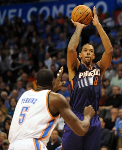 Nov 3, 2013; Oklahoma City, OK, USA; Phoenix Suns power forward Channing Frye (8) attempts a shot against Oklahoma City Thunder center Kendrick Perkins (5) during the second quarter at Chesapeake Energy Arena. Mandatory Credit: Mark D. Smith-USA TODAY Sports