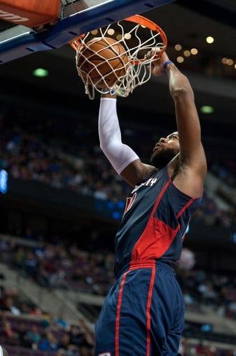 Nov 3, 2013; Auburn Hills, MI, USA; Detroit Pistons center Greg Monroe (10) slam dunks during the third quarter against the Boston Celtics at The Palace of Auburn Hills. Detroit won 87-77. Mandatory Credit: Tim Fuller-USA TODAY Sports