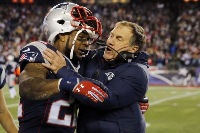 Nov 3, 2013; Foxborough, MA, USA; New England Patriots running back Stevan Ridley (22) is congratulated after his touchdown by head coach Bill Belichick in the second half at Gillette Stadium. The Patriots defeated the Steelers 55-31. Mandatory Credit: David Butler II-USA TODAY Sports